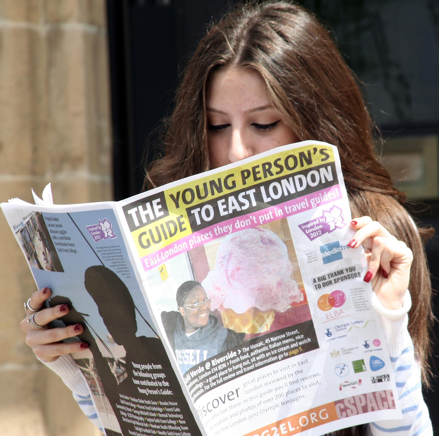 YPG2EL Reading newspaper